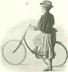 A woman wearing bloomers with her bike.